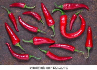 Red hot chilli peppers on dark background. Top view