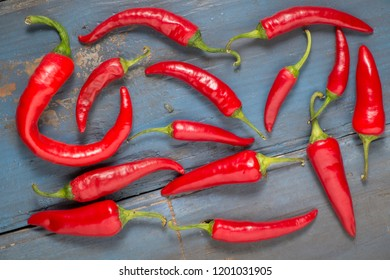 Red hot chilli peppers on a gray board table. Top view