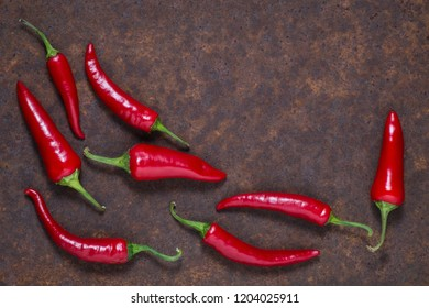 Red hot chilli peppers on dark background. Free space for text . Top view