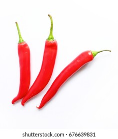 Red hot chilli peppers on the white background. Isolated. Healthy vegetables. Useful food. Vegetarianism. Seasonal harvest. Ingredient of various dishes. National cuisine