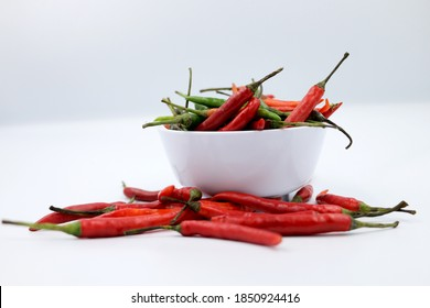 Red hot chilli peppers pattern texture background. Close up. Landscape. A backdrop of Red hot chilli peppers. Street vegetable market. Group of Red hot chilli peppers on white background.