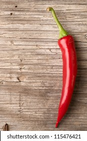 Red hot chillies on wooden table background