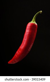 Red hot pepper background black