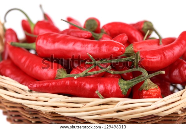 Red hot pepper in basket on white background