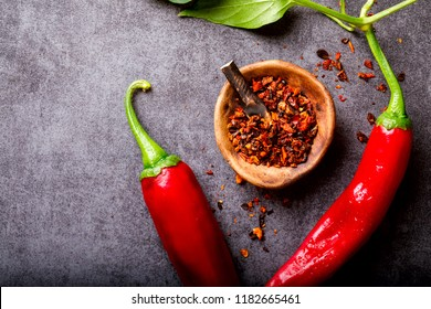 Red Hot Pepper of Chile on a dark background. Spicy food. Seasoning for Cooking.Concept Vegetarian.selective focus.Top View.Copy space for Text.