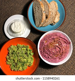 red houmous and guacamole