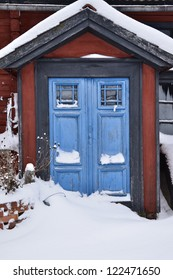Red house with blue doors in winter