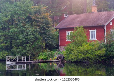 Red house by the lake