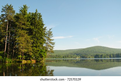 Red House Lake, green forest and mountains