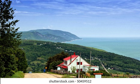 Red house on top of the Mountain and Landscape of La Malbaie Quebec Canada in Background