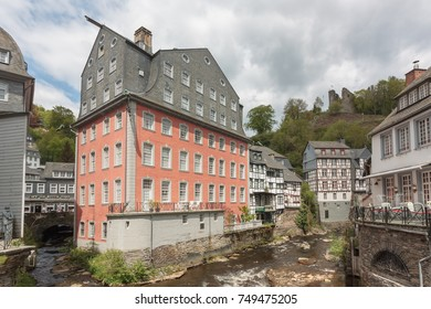 The Red House (Rotes Haus) and other historic buildings along the river Rur in Monschau in the Eifel mountains, Germany.