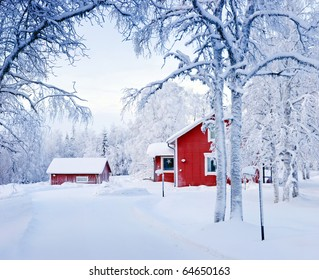 Red house in snow fairy forest. Finland