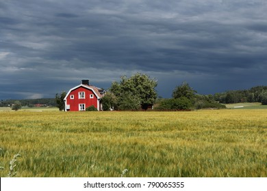 red house in Sweden with dark clouds in the background