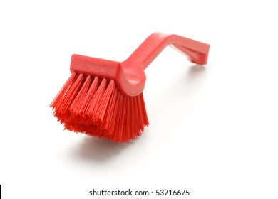 Red household cleaning brush on white background