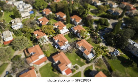 red houses rooftops with green grass in the suburb of israel. tilt shift Bokeh effect for a miniature landscape