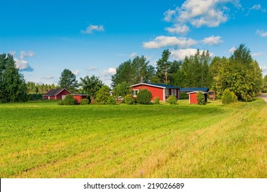 red houses in a rural landscape in Finland