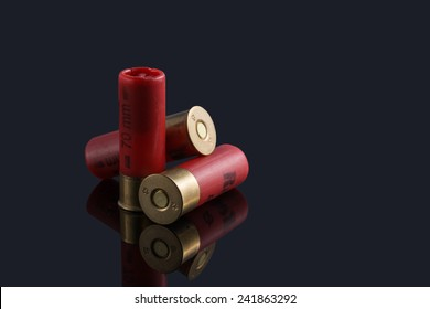 Red hunting cartridges for shotgun on a black background