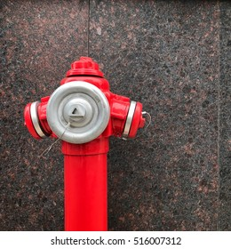 Red hydrant on marble background
