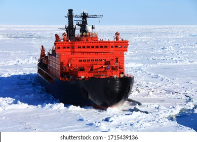 Red icebreaker in the middle of Arctic ocean