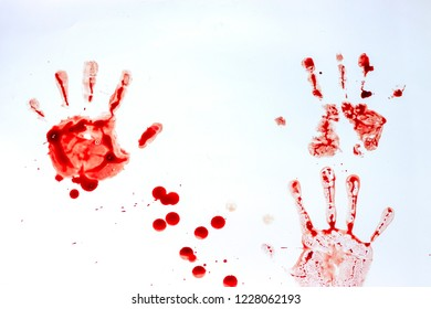 Red imprint of the bloody palm on a white background