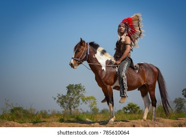 Red Indian sitting on his horse.