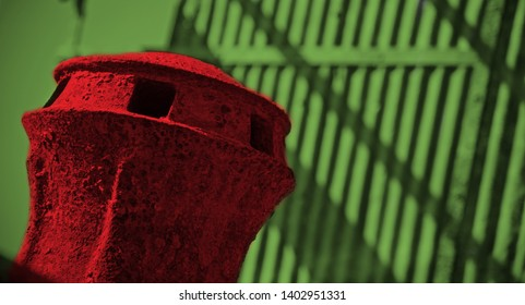 Red iron made round shape object with green background photo
