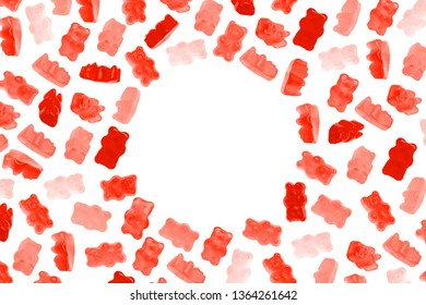 Red jelly candy gummy bears on white background with copy space of round shape. Living coral colors.