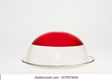 Red jelly in a glass bowl isolated on white