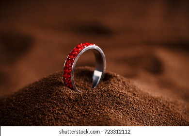 Red jewellery ring on brown background