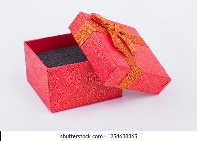 Red jewelry gift box. Small jewellery present box isolated. Beauty and elegance of design.