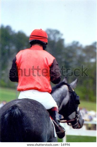 red jockey, grey horse