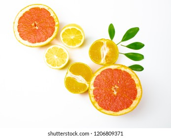red juicy grapefruit, citrus fruits on a white background