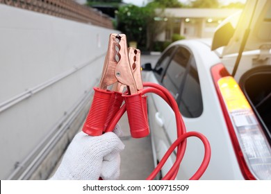 Red Jumper cable for jump start car battery.