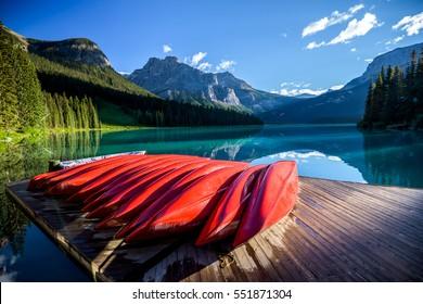 Red kayaks at Emerald Lake in Canadian Rockies, Yoho National Park, Alberta, Canada