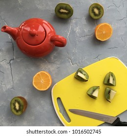 red kettle   and oranges on gray background