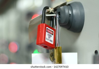 Red key lock and white tag for process cut off electrical on control panel in substation at chemical plants, power plants, oil & gas industry or onshore industry. isolation tag and do not remove tag.