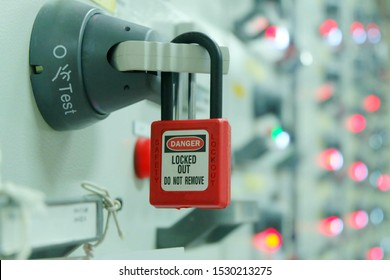 Red key lock and white tag for process cut off electrical on control panel in substation at chemical plants, power plants, oil & gas industry or onshore industry. (Danger locked, out do not remove)