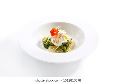 Red king crab with spinach and pear closeup. Seafood dish with fruit and herb isolated on white background. Served delicious food composition. Prepared restaurant gourmet meal in plate