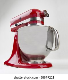 Red kitchen mixer at a low angle with bowl.