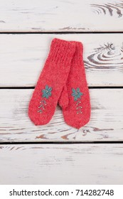 Red knitted mittens for girls' wardrobe. Warm and good-looking accessories made by hand for winter.