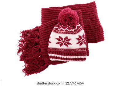 Red knitted wool winter bobble hat scarf isolated white background.