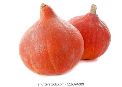 Red kuri squash, small pumpkin in front of white background