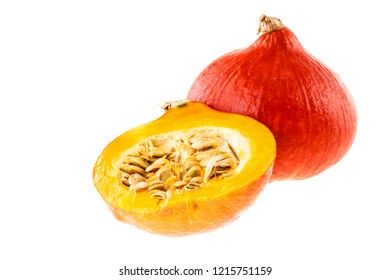 red kuri squash, small pumpkin with a halved one isolated over a white background