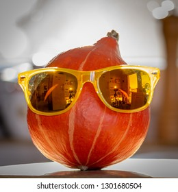 Red Kuri squash with sunglasses.