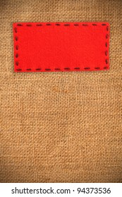 red label on burlap texture