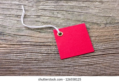 red label on wooden ground/label/red