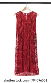 Red lacy sleeveless dress on wooden clothes rack isolated over white