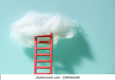 Red ladder to the clouds metaphor. Concept for growth and internet cloud networking. Blue wall.