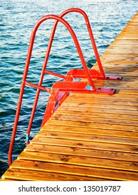 red ladder at a lake