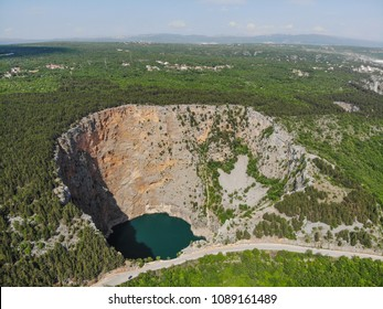 Red Lake (Croatian: Crveno jezero) is a collapse doline (sinkhole) containing a karst lake close to Imotski, Croatia. It is about 530 metres deep, thus it is the largest collapse doline in Europe.